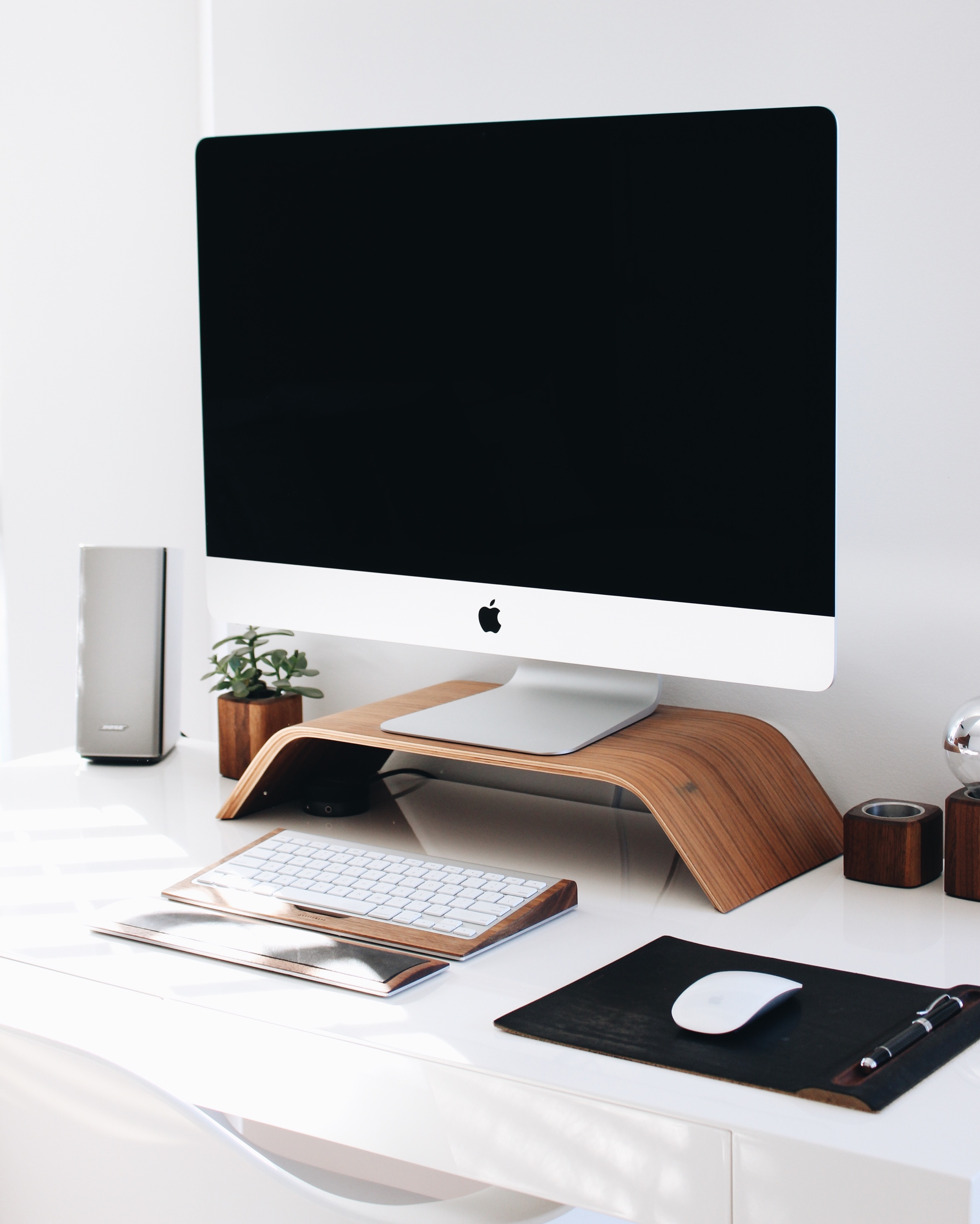scandinavian contemporary desk layout with natural wood desk accessories